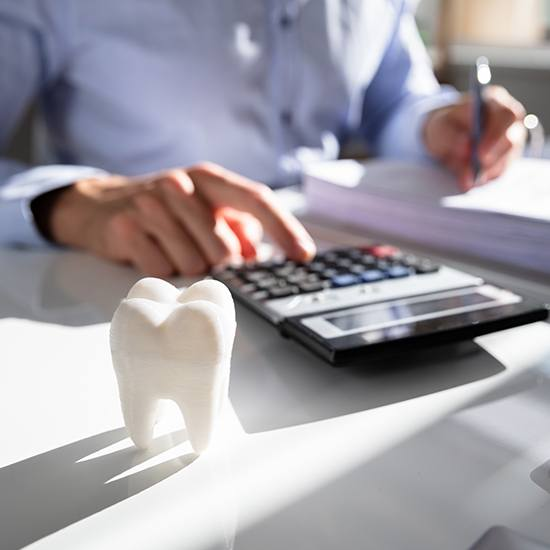 Dentist calculating treatment plan costs