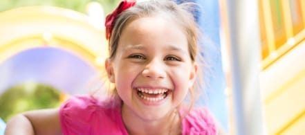 Little girl with healthy smile thanks to children's dentistry