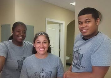 Three team members volunteering together