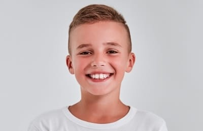 Young boy with healthy smile thanks to children's dentistry