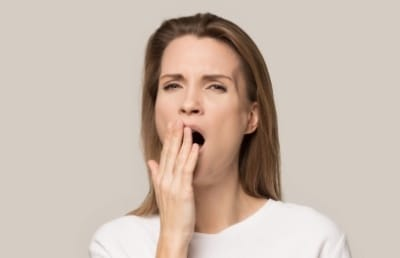 Yawning woman in need of sleep apnea therapy