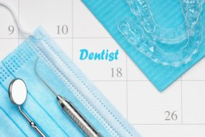 Aligners for Invisalign in Fairfax on top of calendar